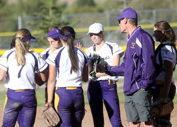 Basalt High School softball coach David Miller talks to the players during a 2018 game. (Photo by Austin Colbert/The Aspen Times)