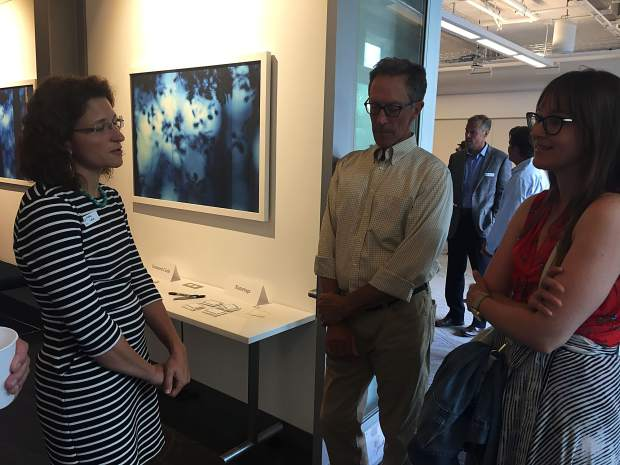 Katie Lewis, a finalist for Aspen's city manager, speaks with John Krueger, the city's directorof transportation and Jessica Garrow, the former community development director for the city, during a meet-and-greet with the public on Thursday.