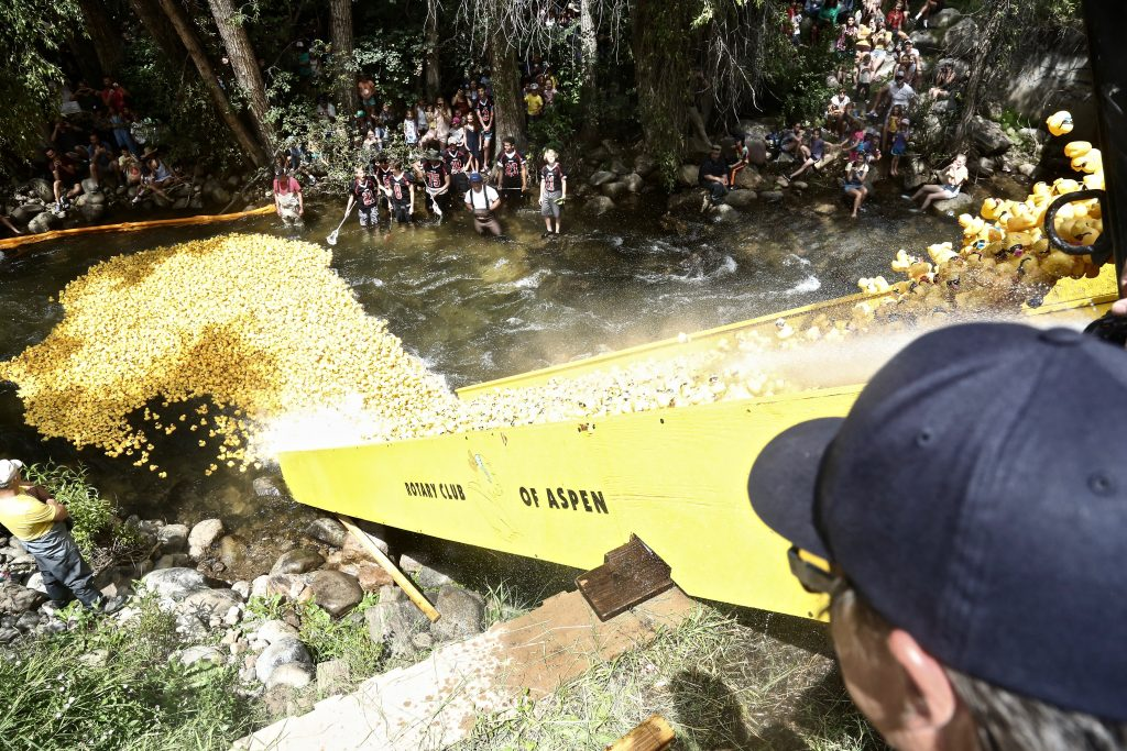 People near Herron Park watch as 20,000 rubber ducks were dropped into the Roaring Fork River on Saturday during the 28th annual Rotary Club of Aspen's Ducky Derby.