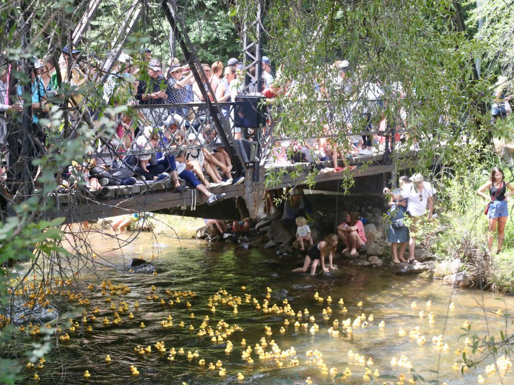 People watch from the No Problem Bridge on Saturday, Aug. 10, 2019, during the 28th annual Rotary Club of Aspen's Ducky Derby along the Roaring Fork River.