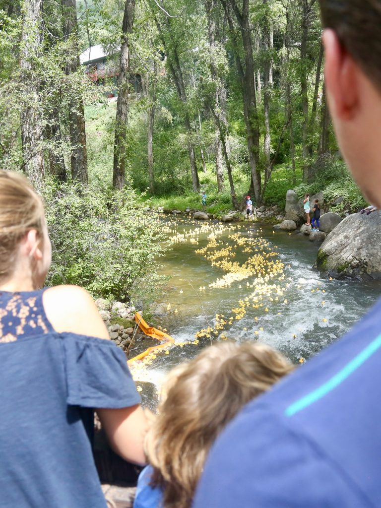 People watch on Saturday, Aug. 10, 2019, during the 28th annual Rotary Club of Aspen's Ducky Derby along the Roaring Fork River.