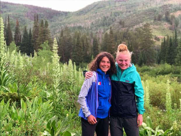 Italian ski mountaineering rising star Samantha Bertolina, left, and Summit County multisport star Grace Staberg pose at Lower Cataract Lake in northern Summit County earlier this summer.
