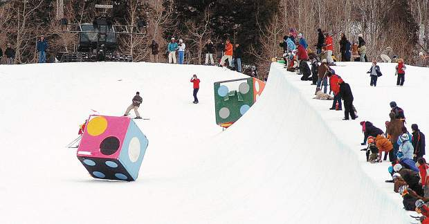 A pair of 8-ft dice tumble down the Superpipe at Buttermilk Sunday, Feb 19, 2006 as part of Japanes artist Yutaka Sone's