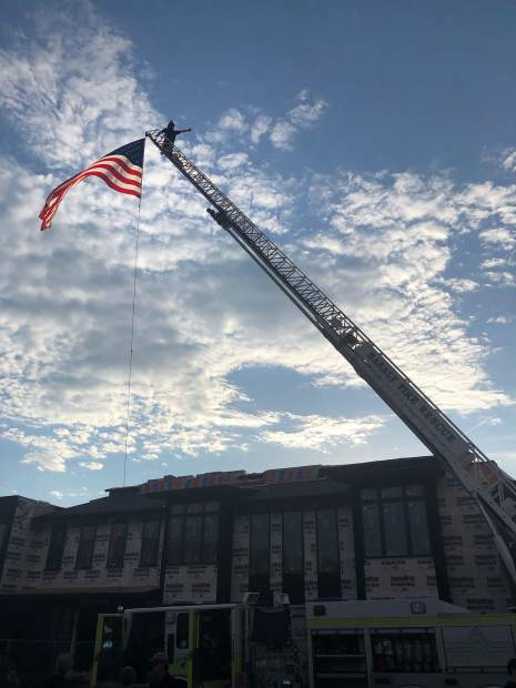 Firefighter David Herrera from Roaring Fork Fire Rescue stands atop Ladder 41 during Basalt's recent National Night Out.