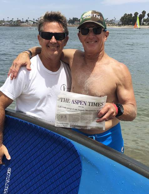 Brothers Ken Morehead of San Diego and Ron Morehead of Aspen (right) take a break from stand-up paddle-boarding in Mission Bay to display The Aspen Times.