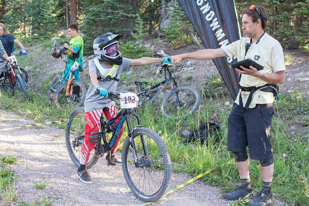Tyler Lindsay, an events and marketing manager for Skico, fist-bumps a racer on Aug. 13 at the start of the last competition in this year's Snowmass Bike Park race series. Lindsay has headed the series for the past two years, and hopes to see it continue to bring in more awesome riders moving forward.