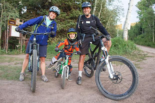From left, Lindsay, Will and Chris Halsey stand for a photo in the Snowmass Bike Park on Aug. 13.