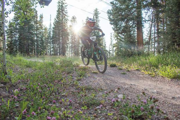 A racer descends out of the start line during the Snowmass Bike Park race series on Aug. 13.