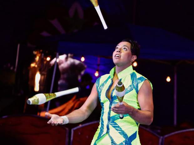A performer entertains the crowd during Circus Bella on Friday, Aug. 23, 2019, in Snowmass Base Village. (Photo by Austin Colbert/The Aspen Times)