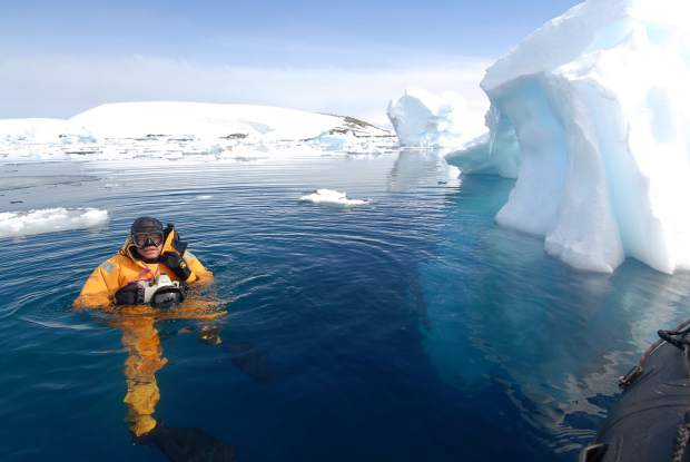 Photographer and filmmaker Pete McBridge surfaces and tries to smile through numb lips while diving in Antarctica.