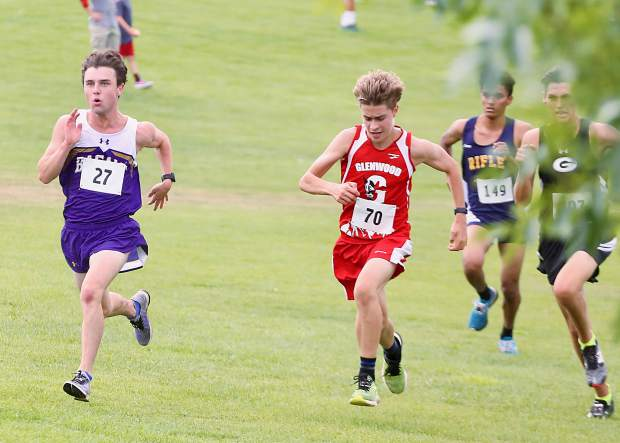 Basalt High School senior Tucker Bruce, far left, sprints to the finish of the Longhorn Invitational on Saturday, Aug. 24, 2019, at Crown Mountain Park. Bruce finished fourth in 18:58.3. (Photo by Austin Colbert/The Aspen Times)