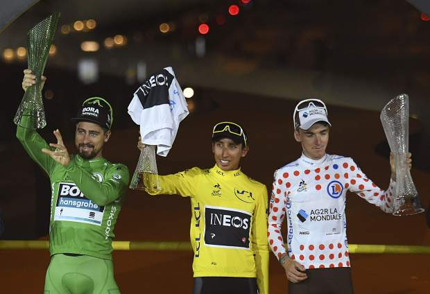 Colombia's Egan Bernal, the winner, center, Slovakia's Peter Sagan wearing the best sprinter's green jersey, left, and France's Romain Bardet wearing the best climber's dotted jersey, from left, stand on the podium of the Tour de France cycling race in Paris, France, Sunday, July 28, 2019.