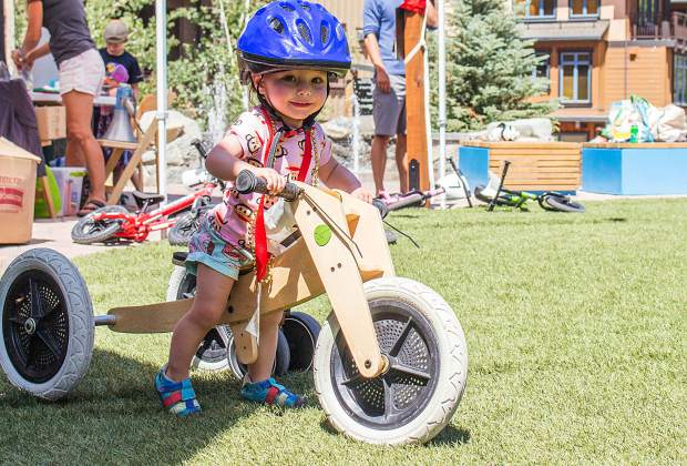Tanner Spung, 1, rides her strider bike on Sunday, Aug. 18, 2019, outside of The Collective building in Snowmass Base Village. While adults were taking on the BME Finals, toddlers like Spung were racing strider bikes.