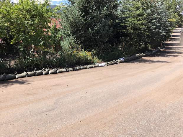 The Basalt town government placed sandbags on Sopris Drive to help divert water from a residence that was affected by Sunday's downpour. The sandbags will remain in place during monsoon season.