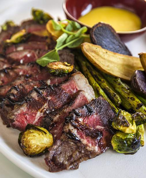 W Aspen executive chef Jackie Siao's menu of international comfort fare includes steak with roasted vegetables