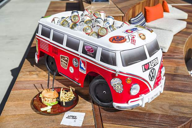 a custom-built VW bus cooler is parked on the Wet Deck rooftop pool bar beside the Fancy Pantsy Burger, a wagyu beef patty with two cheeses, maple-pepper bacon, and truffled Béarnaise sauce