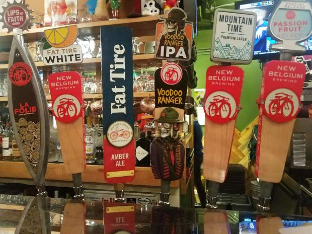 New Beligum fills the taps at Snowmass's Ranger Station.