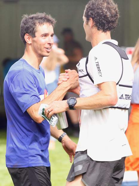 Aspen's Noah Hoffman, left, greets Gunnison's Joshua Eberly at the finish line of the Aspen Backcountry Marathon on Saturday, Aug. 10, 2019, at Rio Grande Park. Hoffman, a former professional cross-country skier and two-time Olympian, won the race in 3 hours, 30 minutes, while Eberly took second. (Photo by Austin Colbert/The Aspen Times)