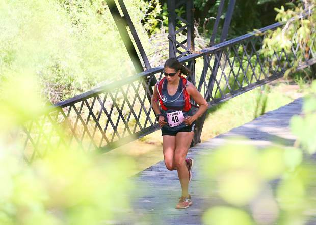 Kelsey Persyn of Texas approaches the finish line of the Aspen Backcountry Marathon on Saturday, Aug. 10, 2019, at Rio Grande Park. Persyn defended her 2018 title by winning the women's race yet again. (Photo by Austin Colbert/The Aspen Times)