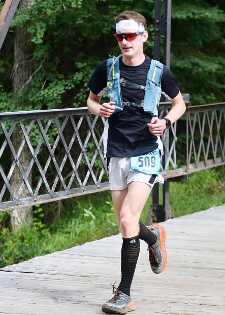 Denver's Carter Peterzalek approaches the finish line of the Aspen Backcountry Half Marathon on Saturday, Aug. 10, 2019, at Rio Grande Park. (Photo by Austin Colbert/The Aspen Times)