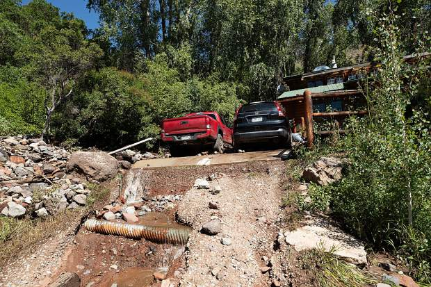 Flash flood damage at Debbie Redmount and Sean Kelly's home on Cedar Drive on Monday as a result from the rainstorm Sunday night.