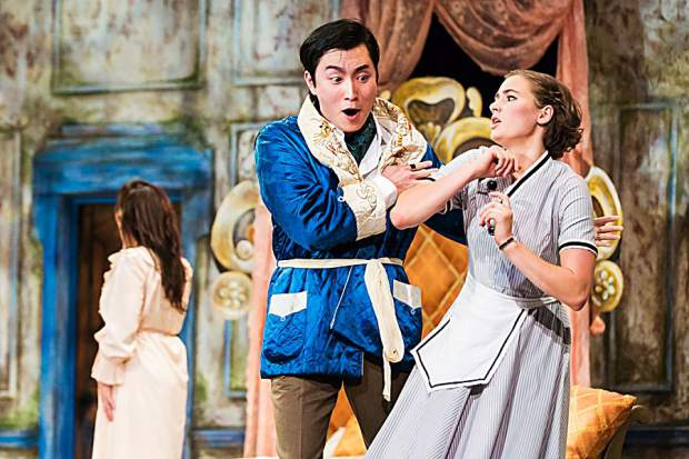 "Xiaomeng Zhang, left, as Count Almaviva grabs the arm of Susanna, played by Jessica Niles, in Aspen Opera Theater's production of Mozart's ""Le Nozze di Figaro"""