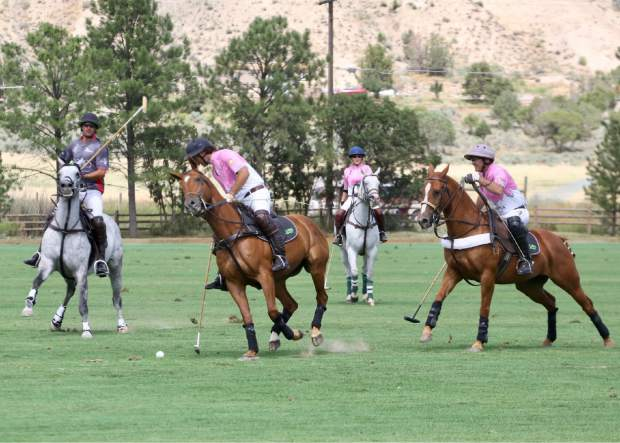 A match is played during the Aspen Valley Polo Club's Chukkers, Champagne & Caviar fundraiser for the Aspen Valley Hospital Foundation on Sunday, Aug. 11, 2019, at McClure River Ranch near Carbondale. (Photo by Austin Colbert/The Aspen Times)