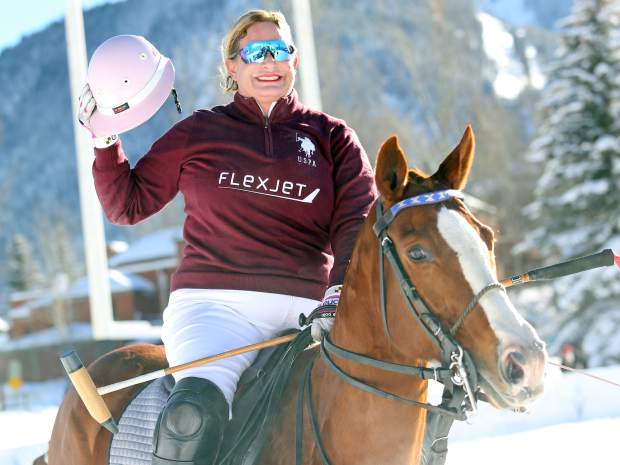 Melissa Ganzi salutes the crowd during the 2016 World Snow Polo event at Rio Grande Park in Aspen. (Photo by Austin Colbert/The Aspen Times)