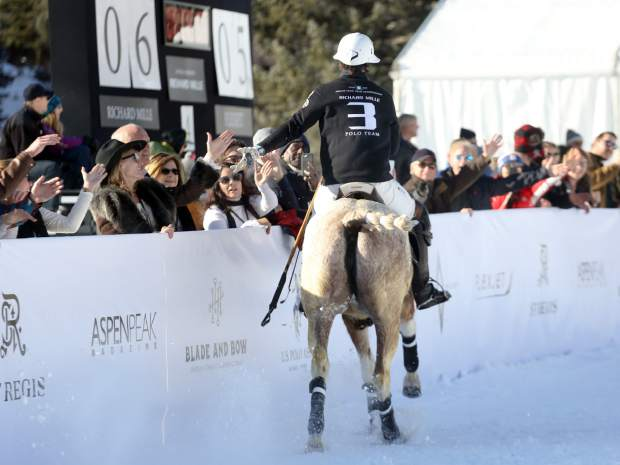 A player greets fans during the final of the 2018 World Snow Polo Championship on Thursday, Dec. 20, 2018, at Rio Grande Park in Aspen. (Photo by Austin Colbert/The Aspen Times)