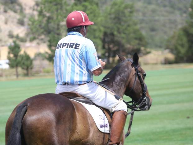 An umpire sits idle during the Aspen Valley Polo Club's Chukkers, Champagne & Caviar fundraiser for the Aspen Valley Hospital Foundation on Sunday, Aug. 11, 2019, at McClure River Ranch near Carbondale. (Photo by Austin Colbert/The Aspen Times)
