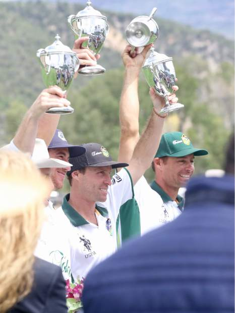 Players hold up one of a few trophies handed out during the Aspen Valley Polo Club's Chukkers, Champagne & Caviar fundraiser for the Aspen Valley Hospital Foundation on Sunday, Aug. 11, 2019, at McClure River Ranch near Carbondale. (Photo by Austin Colbert/The Aspen Times)