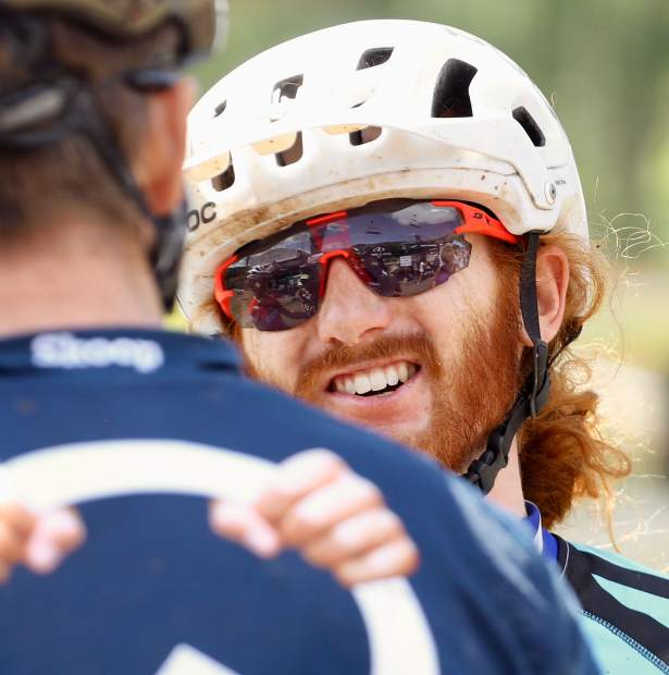 Runner-up finisher and Triple Crown winner Cam Smith of Gunnison chats with fellow competitors after the Audi Power of Four mountain bike race on Saturday, Aug. 17, 2019 in Snowmass. (Photo by Austin Colbert/The Aspen Times)
