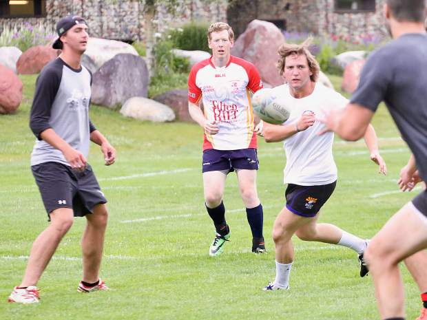 The Gentlemen of Aspen Rugby Club warms up with a game of touch during practice on Thursday, Aug. 1, 2019, at Rio Grande Park in Aspen. (Photo by Austin Colbert/The Aspen Times)