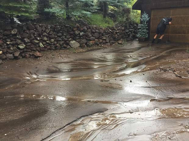 Rob Griem fights to control the mud entering his driveway on Cedar Drive in Basalt during the Aug. 4 flash flood. The Griems had to remove 20 tons of mud and debris.