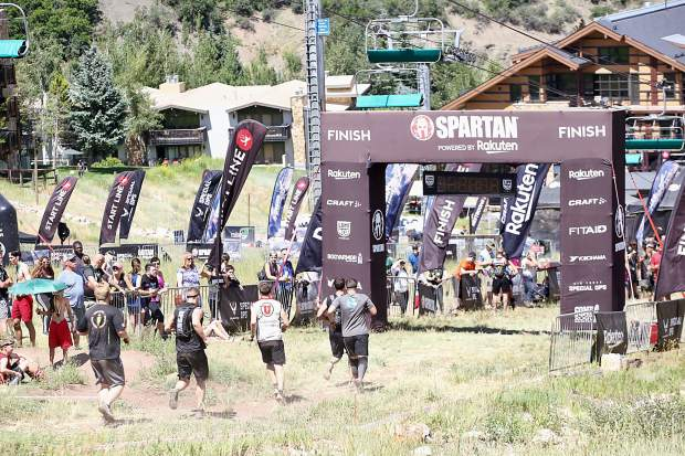 Athletes reach the finish line on Saturday, Aug. 3, 2019, during the first-ever Spartan obstacle-course race in Snowmass. (Photo by Austin Colbert/The Aspen Times)