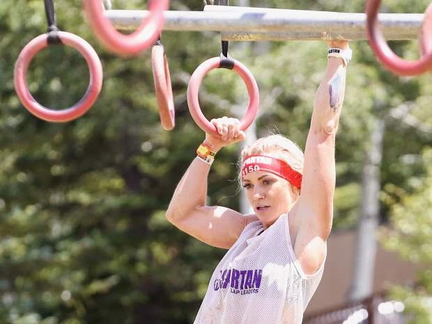 An athlete makes her way across the multi-rig on Saturday, Aug. 3, 2019, during the first-ever Spartan obstacle-course race in Snowmass. (Photo by Austin Colbert/The Aspen Times)