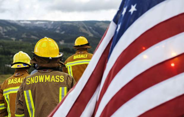 Roaring Fork firefighters from Snowmass and Basalt trek up to the Top of the Village in Snowmass for the Axes and Arms 9/11 Climb on Wednesday, September 11, 2019. (Kelsey Brunner/The Aspen Times)