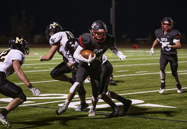 Aspen Skiers' Jonathon Woodrow (24) runs the ball during the third quarter of the varsity game against Meeker High School on Friday, September 13, 2019. (Kelsey Brunner/The Aspen Times)