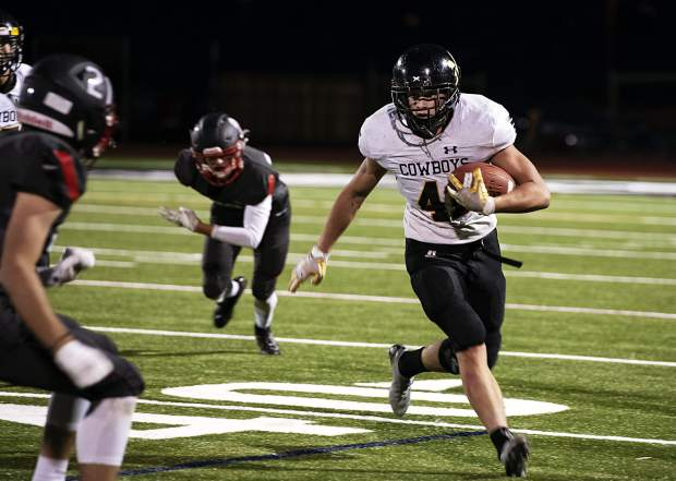 Meeker Cowboys' Jeremy Woodward runs the ball during the varsity game in Aspen on Friday, September 13, 2019. (Kelsey Brunner/The Aspen Times)