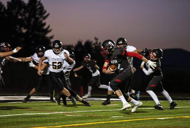 Aspen Skiers Jon Haisfield (12) runs the ball during the game against Meeker High School in Aspen on Friday, September 13, 2019. (Kelsey Brunner/The Aspen Times)