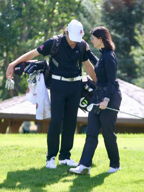 Aspen High School boys golf coach Mary Woulfe, right, talks with senior Jack Pevny on the 17th hole on Tuesday, Sept. 3, 2019, during the Skiers' home tournament at Aspen Golf Club.