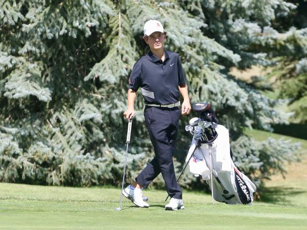 Aspen High School sophomore Nic Pevny awaits his final putt on the 18th green on Tuesday, Sept. 3, 2019, during the Skiers' home tournament at Aspen Golf Club.