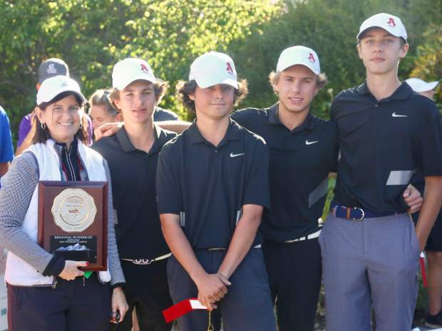 The Aspen High School golf team poses with the team runner-up plaque after the regional on Wednesday, Sept. 25, 2019, at Aspen Golf Club. (Photo by Austin Colbert/The Aspen Times)