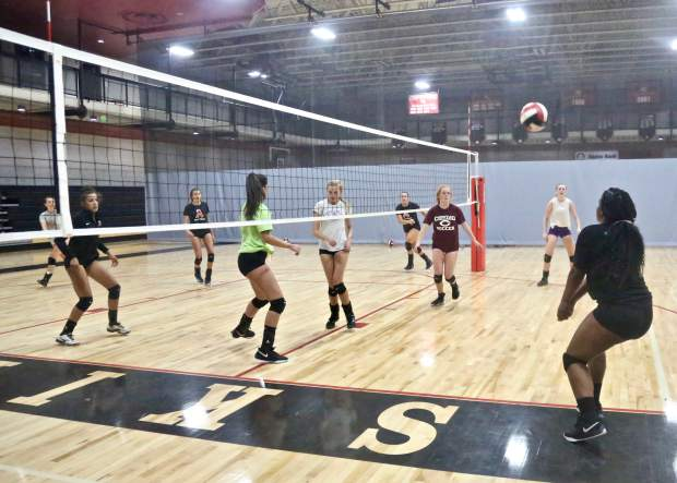 The Aspen High School volleyball team practices on Tuesday, Sept. 10, 2019, inside the AHS gymnasium. (Photo by Austin Colbert/The Aspen Times)