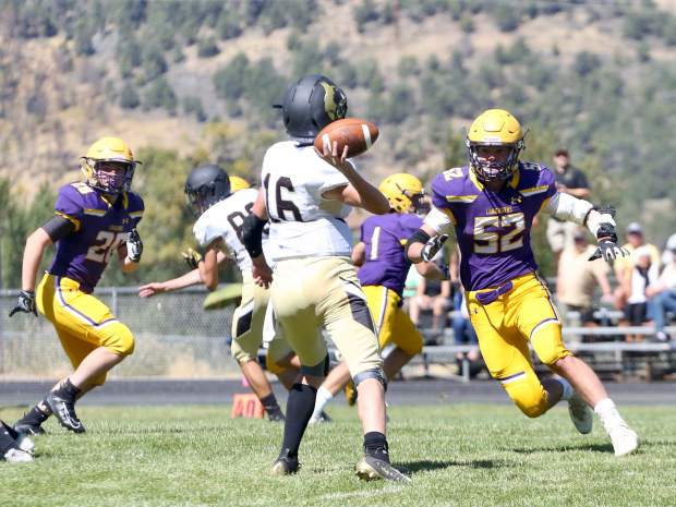 Basalt High School senior Lander McNamee chases down Battle Mountain quarterback Kai Haggen during their game on Saturday, Sept. 14, 2019, on the BHS field. The Longhorns won, 28-0. (Photo by Austin Colbert/The Aspen Times)