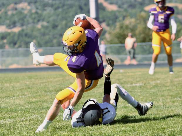 Basalt High School sophomore Cole Dombrowski is tripped up by a Battle Mountain defender is their game on Saturday, Sept. 14, 2019, on the BHS field. The Longhorns won, 28-0. (Photo by Austin Colbert/The Aspen Times)