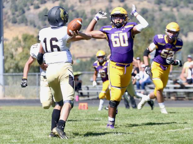 Basalt High School sophomore Wyatt Upton jumps to defend against a Battle Mountain pass during their game on Saturday, Sept. 14, 2019, on the BHS field. The Longhorns won, 28-0. (Photo by Austin Colbert/The Aspen Times)