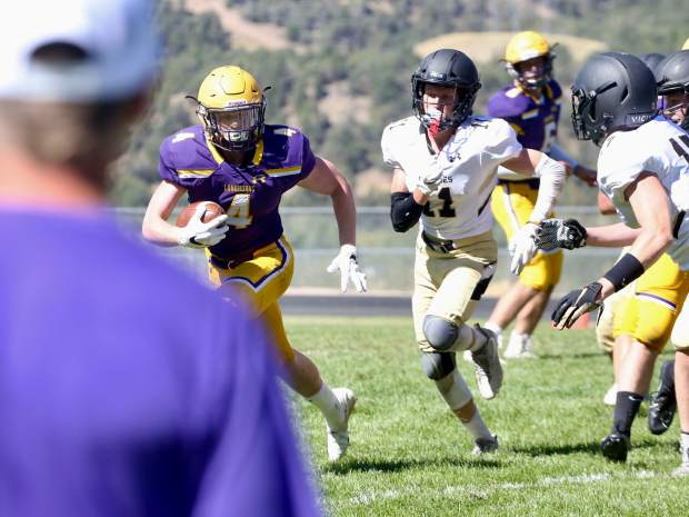 Basalt High School sophomore Cole Dombrowski carries the football against Battle Mountain on Saturday, Sept. 14, 2019, on the BHS field. The Longhorns won, 28-0. (Photo by Austin Colbert/The Aspen Times)