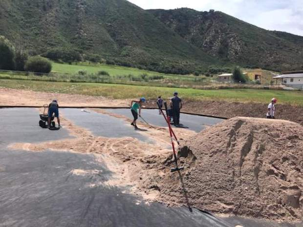 Volunteers help create the new shot put area on the Basalt High School campus on Aug. 24, 2019.