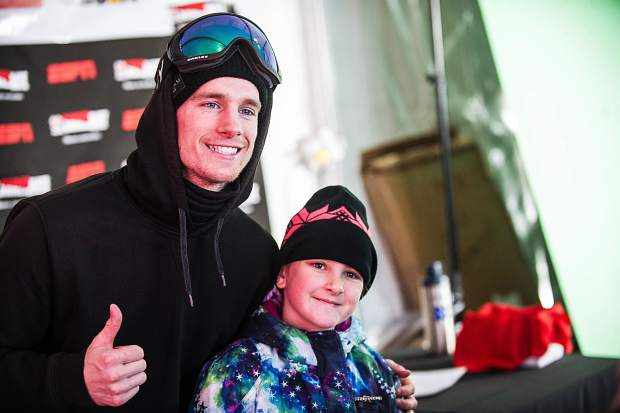 Max Parrot poses for a picture at X Games Aspen in January of 2017 with Kaitlyn Felten, 9, of Denver, at the Buttermilk venue. Parrot was diagnosed with cancer in December of 2018.